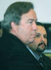 John Lopez (right) and public defender K.C. Williamson