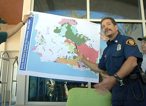 BLAZE OF GLORY:  County Fire Captain Eli Iskow, pictured above briefing the media about the burn area of 2007's Zaca Fire, retired last month after nearly three decades on the job.