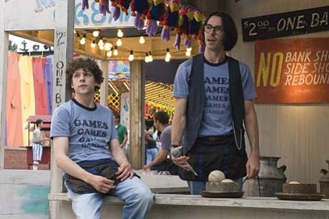 James Brennan (Jesse Eisenberg) and Joel (Martin Starr) are employees of <em>Adventureland</em>.