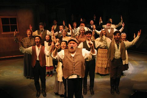 Jay Brazeau as Tevye, leading the village in song and dance in Rubicon's production of <em>Fiddler on the Roof</em>.