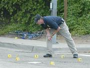 SBPD traffic investigator Mark Hunt surveys the scene of a accident where bicyclist Johan Montoyaon was hit and severly injured by an SUV on Mission St. at the 101 underpass April 7, 2008