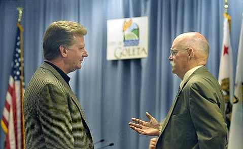 HASKELL'S HASSLE:  Chuck Lande (left) explains benefits of the proposed Haskell's Landing development to Goleta City Councilmember Ed Easton, who wanted more info about General Plan changes associated with the project's approval.