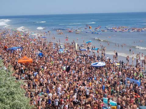 BEACH BLANKET BABYLON:  About 12,000 people-mostly Isla Vista residents-packed the beach for this year's Floatopia, an event that seems set to rival I.V.'s infamous Halloweens in terms of whopping attendance and debauchery. Some are already planning Floatopia 2.