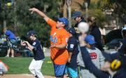 Mets Kevin Lynch (center) warms up