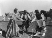Gauchos play-fight in Argentina in the early 1900s.