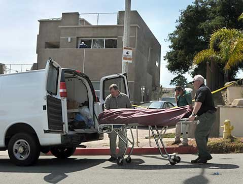 Santa Barbara Coroner officers remove the victims' remains from 621 Aurora Ave May 4, 2009.