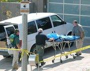 Santa Barbara Coroner officers remove the victims' remains from 621 Aurora Ave May 4, 2009.