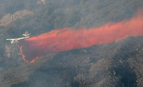 An air tanker drops fire retardant on the Jesusita Fire.