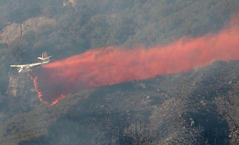 An air tanker drops fire retardant on the Jesusita Fire.