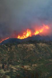 Looking from Tea Fire area (Conejo Road) toward Jesusita Fire burning in Rattlesnake Canyon (road is West Mountain Drive)