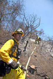 Hand crews begin to build containment line in Maria Ygnacio Canyon east of Painted Cave.