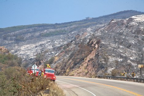 Engine crew from Smartsville CA begin to assess hot spots above Highway 154.