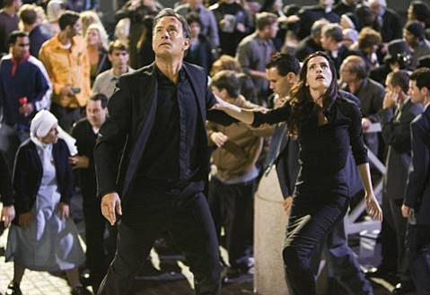 Symbologist Robert Langdon (Tom Hanks) works with a physicist (Ayelet Zurer) to uncover the truth about the Illuminati in <em>Angels & Demons</em>.