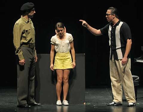 Matthew Horn, Amanda Berning, and Charlie Faith in a scene from <em>La Ni±era</em>.