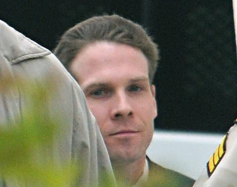 <strong>THE ACCUSED: </strong> Jesse James Hollywood is brought into court each morning under tight security behind shielded  fences and walls.