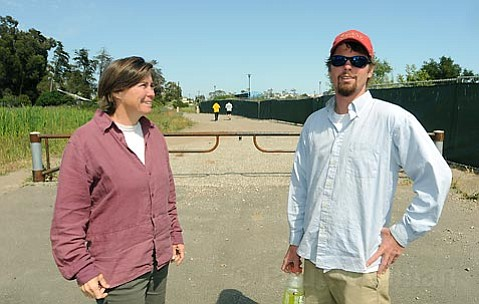 "<strong>Developing dispute:</strong>  Lisa Stratton, natural areas director at UCSB's Cheadle Center for Biodiversity and Ecological Restoration, and David ""Gravy"" Harris, San Clemente Project manager, tour the space alleged by some to have been a wetland developed without proper permission. UCSB officials claim the dispute results from a misunderstanding."