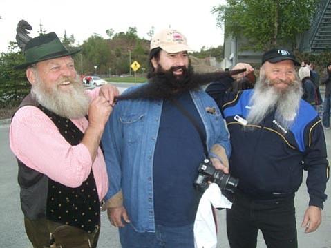 Austrian beard masters Fritz Sendlhofer and Hans Gassner test Bruce Hagen's authenticity at the Beard BBQ