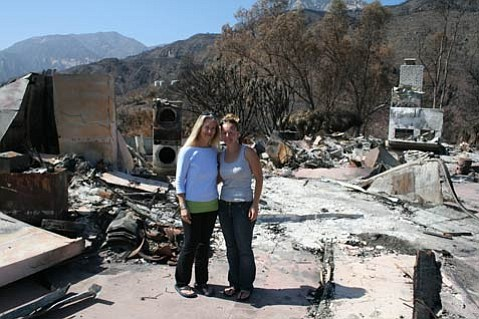 Nancy (left) and Karen Keltner stand in front of what used to be their house.
