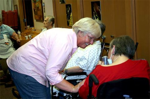 Marianne Wohler, Valle Verde Director of Nursing, comforting an evacuee.