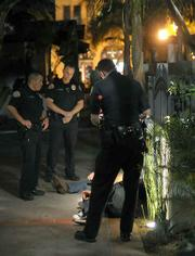 Police detain suspects involved in a late night fight
