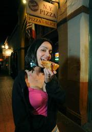 Maria Sarmiento enjoying a slice from Uncle Rocco's.