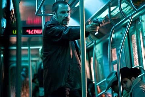 John Travolta is Ryder, the bad guy in <em>The Taking of Pelham 123</em>.