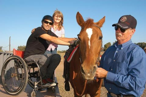 <strong>Helpful horses:</strong>  Ray (left) works with Bruce Bennett (right) and Hearts Adaptive Horseback Riding's Connie Weinsoff (center).