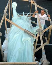 Rex Stephens standing next to  the 500-pound, 16-foot-tall Statue of Liberty replica commissioned by the Spirit of '76 Foundation arrived in Santa Barbara on Monday, July 6, and will be unveiled at this weekend's French Festival in Oak Park.