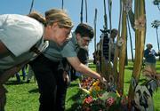 Thelma Thrapani (left) and Rabbi Arthur Gross-Schaefer view the homeless memorial