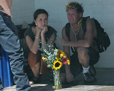 Social worker Jennifer Ferraez (left) spends some time with Mike Mallon after the ceremony