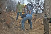Volunteers on National Trails Day June 13 help to remove loose rock that has tumbled down off trail.