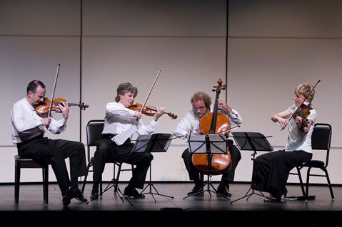 Edward Dusinberre (violin), K¡roly Schranz (violin), Andr¡s Fejer (cello), and Geraldine Walther (viola) together make up the Tak¡cs Quartet, a mainstay of the Music Academy's visiting artists program.