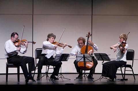 Edward Dusinberre (violin), K¡roly Schranz (violin), Andr¡s Fejer (cello), and Geraldine Walther (viola) together make up the Tak¡cs Quartet, a mainstay of the Music Academy's visiting artists program.
