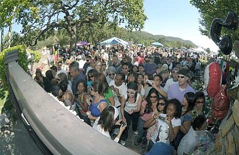 <strong>IT'S BAD, YOU KNOW IT:</strong>  A crowd of Michael Jackson mourners clusters at the Neverland Ranch on July 3. To some, the transformation of Jackson's former Los Olivos estate into a Graceland-like tourist attraction would threaten the future of the Santa 