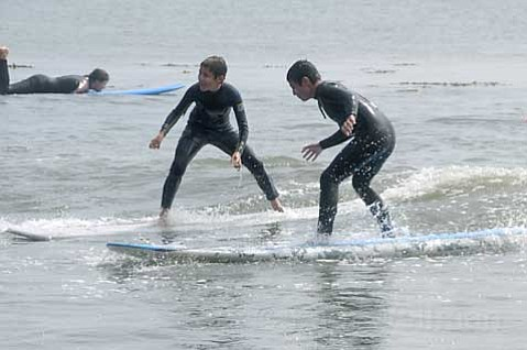 Miguel Angel Weedn (left) catches waves with childhood friend  Andres