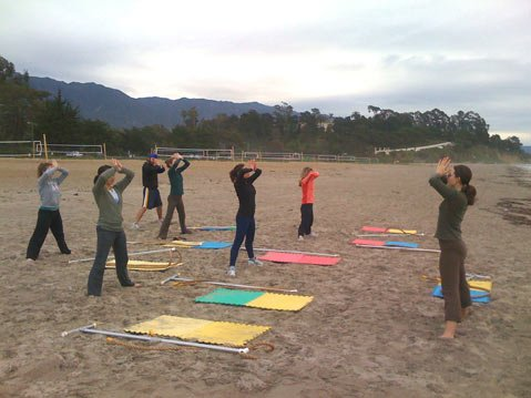 A rope-based yoga class at East Beach.