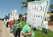 Outside the Double Tree Resort local 3299 union workers protest pay cuts