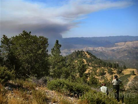 Park Rangers watch the early stages of the La Brea Fire from the top of Figueroa Mountain at 2:55 p.m. Saturday Aug. 8, 2009