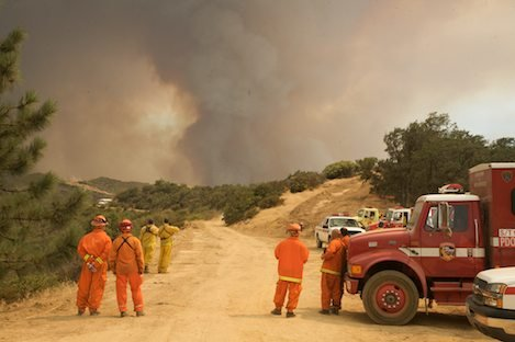 Fire fighters look eastward as the La Brea Fire advances up out of the Sisquoc drainage towards the Sierra Madres.
