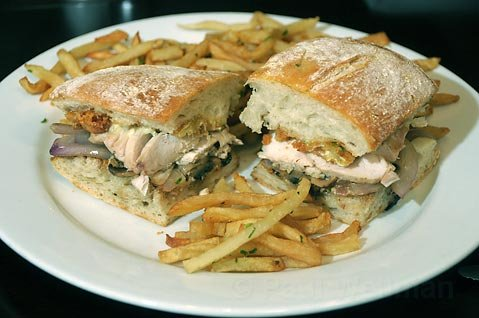 Grilled chicken sandwich with fries at Jane.
