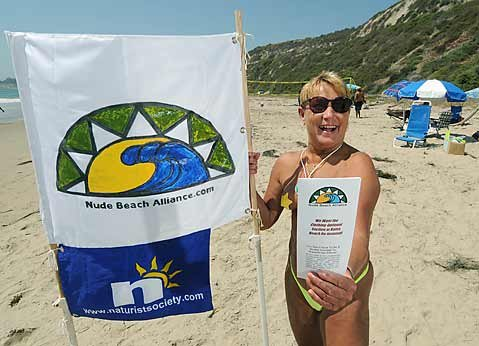 Sonya Robinson passes out literature on the Nude Beach Alliance