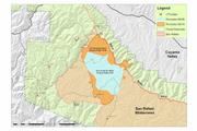 Sunday's and Monday's fire perimeters are overlayed showing the main expansion is towards the Sierra Madres.
