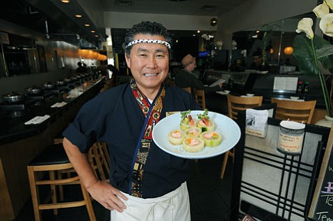 "<strong>Dig in:</strong> Kai Sushi Shabu-Shabu owner Kazumoto ""Kaz"" Sato with a Whiter Roll."