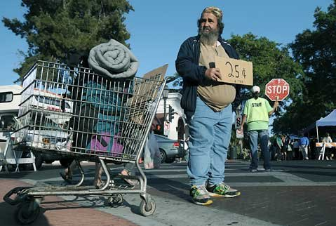 "<strong>CHOICES FOR BEGGARS:</strong>  Under the city's new ordinance, passive panhandling with a sign, as practiced by David ""Homeless,"" will still be protected by free speech laws and allowed. Threatening or insulting language or behavior, however, will be verboten, as will any panhandling near bank lines, outdoor restaurants, and movie theater queues."
