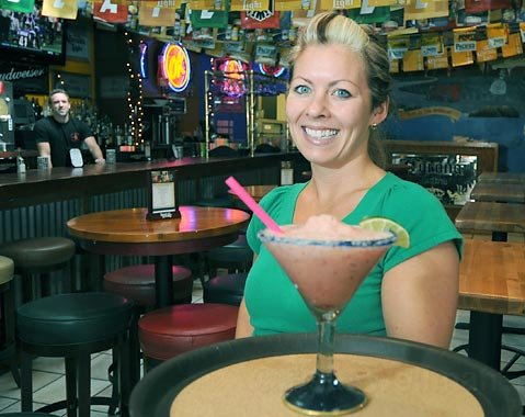 Hang a left:  Left at Albuquerque's General Manager Jenny Strong, with a crushed grape margarita.