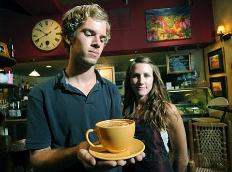 <strong>NorthStar:</strong>  Baristas Thor Benson (left) and Dasha Perkins serve up a double latte at the State Street coffee house.
