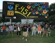 """Participants in The Big Read kickoff party dance to Ohio Players' """"Fire"""""""