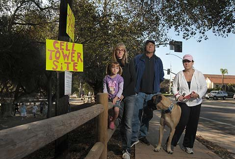 "<strong>ANTI-ANTENNA BRIGADE:</strong>  The move to put up more than 100 wireless data antennas throughout southern Santa Barbara County is riling some residents. Topping that list are (from left) four-year-old Arielle; Arielle's mom, Cindy Feinberg; Don Miller; and Carrie Haffner; as well as other parents and neighbors of Montecito Union School, where an antenna is proposed across the street from the playground. ""There are people involved in big cellular companies, pushing their way into our communities without any ability for us to speak about placing these things away from our residential neighborhoods,"" said Goleta's Yuri Zelez, whose bedroom is 25 feet from a proposed antenna. ""It's like, 'Bend over and take it.' Forget it. I'm not doing that."""