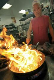 <strong>Uncle Chen Restaurant:</strong>  The Carpinteria restaurant's owner and head chef Tsai-Wang Lee fires up something delicious for his customers.