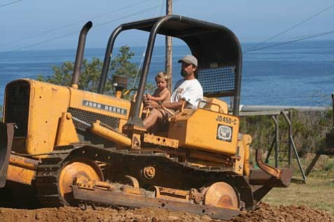 <strong>Sowing Seeds:</strong>  One of the longest-running family ranches on the Gaviota Coast, Orella Ranch today remains in business while fast becoming a beacon for agriculture's new world order of sustainability. Orella owner Guner Tautrim and his son, Sequoia, make tracks on the property.